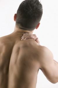 Man Rubbing His Shoulder Muscle